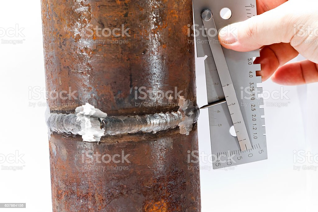 Measurement of the geometric dimensions of weld of pipeline seam stock photo