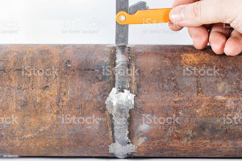 Measurement of the geometric dimensions of weld pipeline seam stock photo