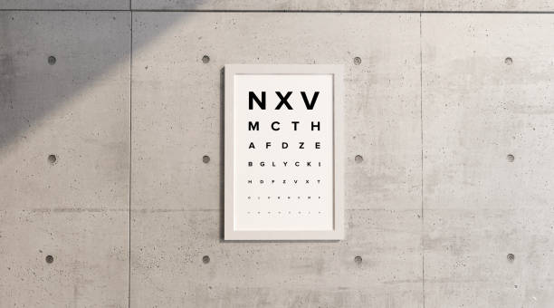 Measurement table of sight. Framework hanging on a concrete wall. View examination. Letters in block letters. Eye test. Visual Acuity stock photo