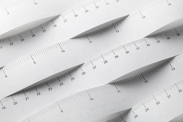 measurement units. tape measures in meters and inches. - measuring stock pictures, royalty-free photos & images