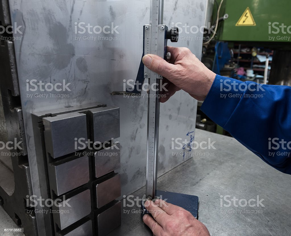 measurements of a steel plate using a planer stock photo