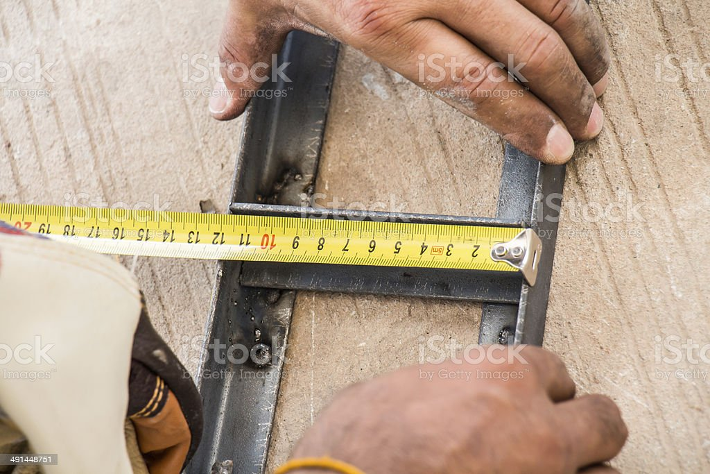 Measuring a steel stock photo