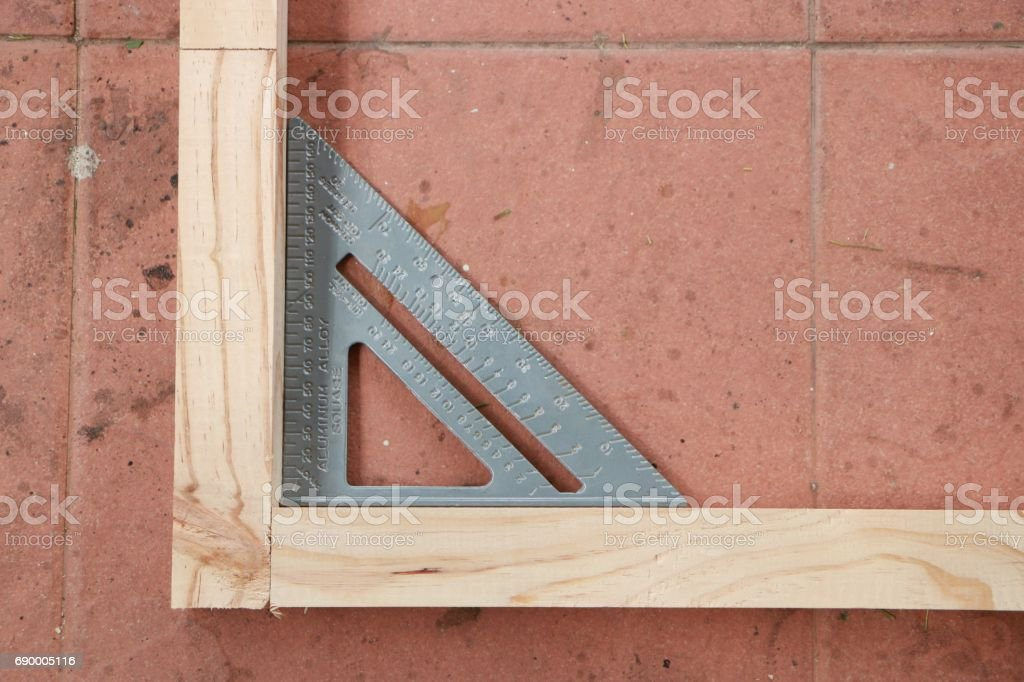 Measuring angle of wooden structure for making furniture stock photo