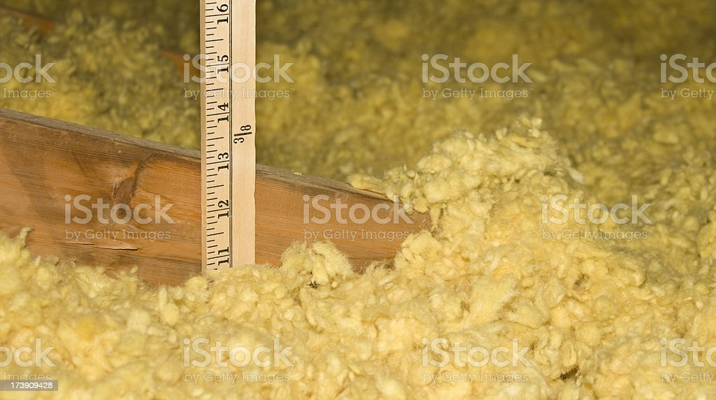 Measuring Attic Insulation stock photo