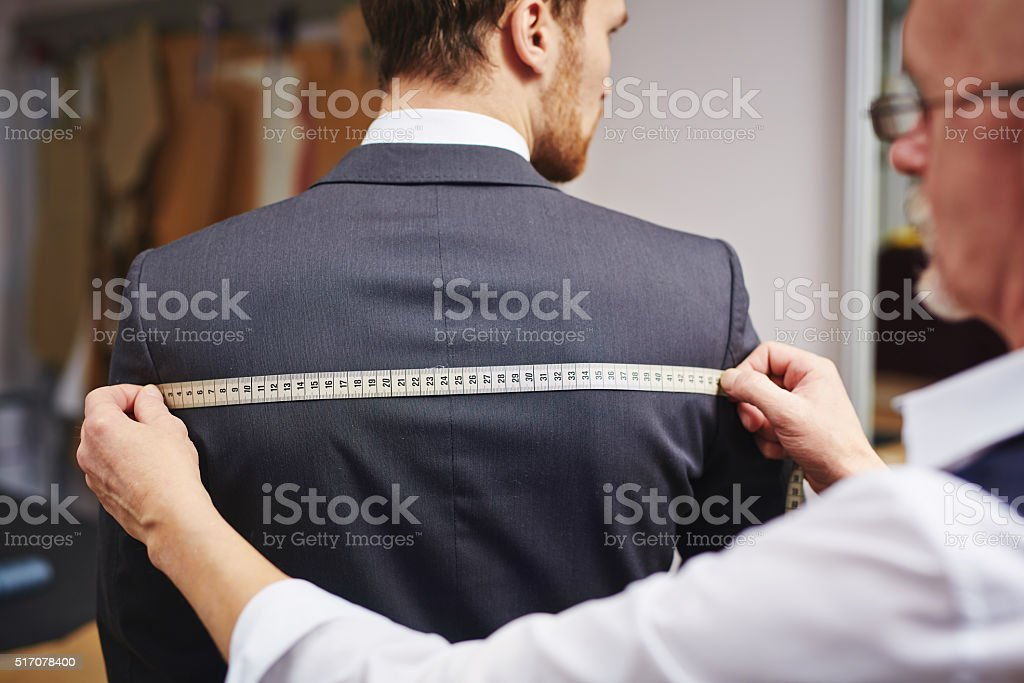 Measuring back of jacket stock photo
