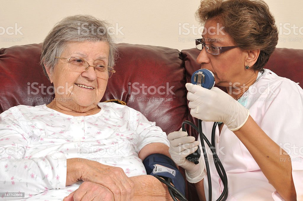 Measuring blood pressure royalty-free stock photo