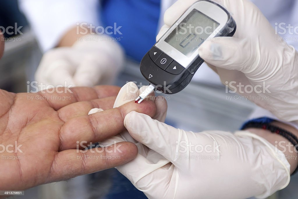 Measuring blood sugar stock photo