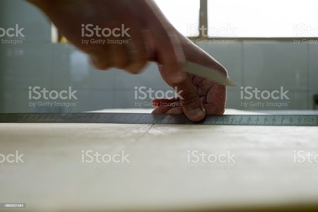 Measuring Croissant Dough to Cut stock photo