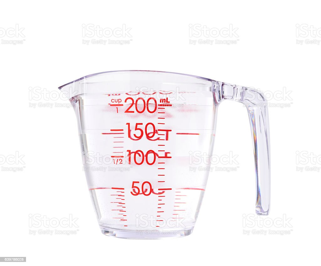 Measuring cup full of water on white background stock photo