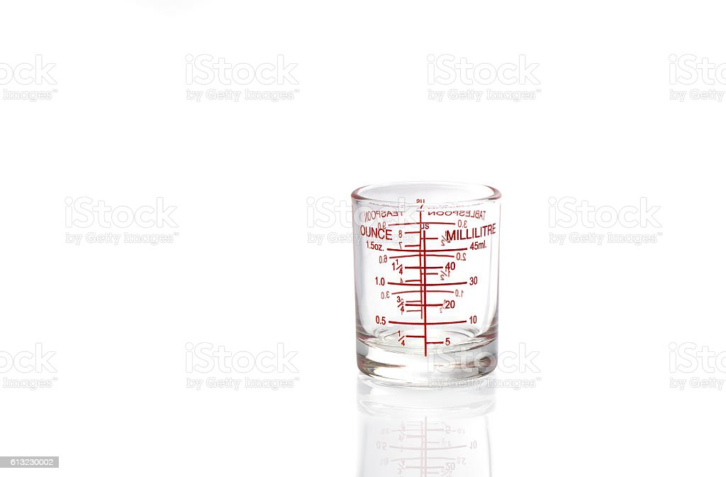 Measuring cup on white background. stock photo
