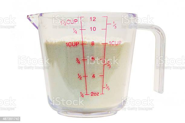 Measuring Cup With Flour 1 Stock Photo Download Image Now Istock