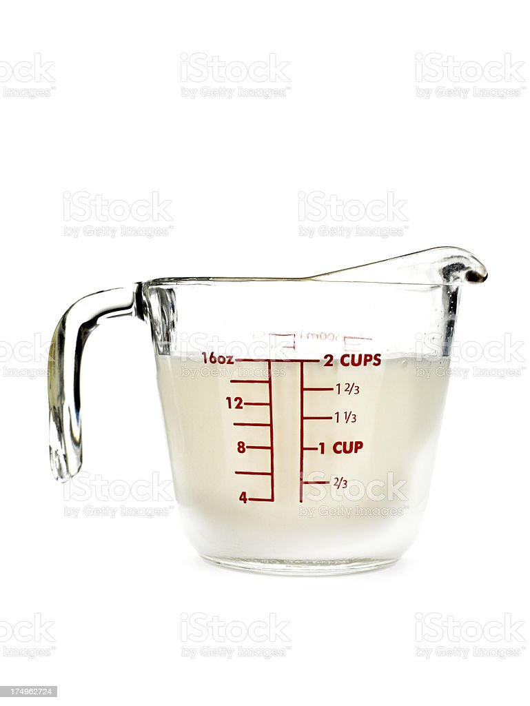 Measuring Cup with Milk stock photo