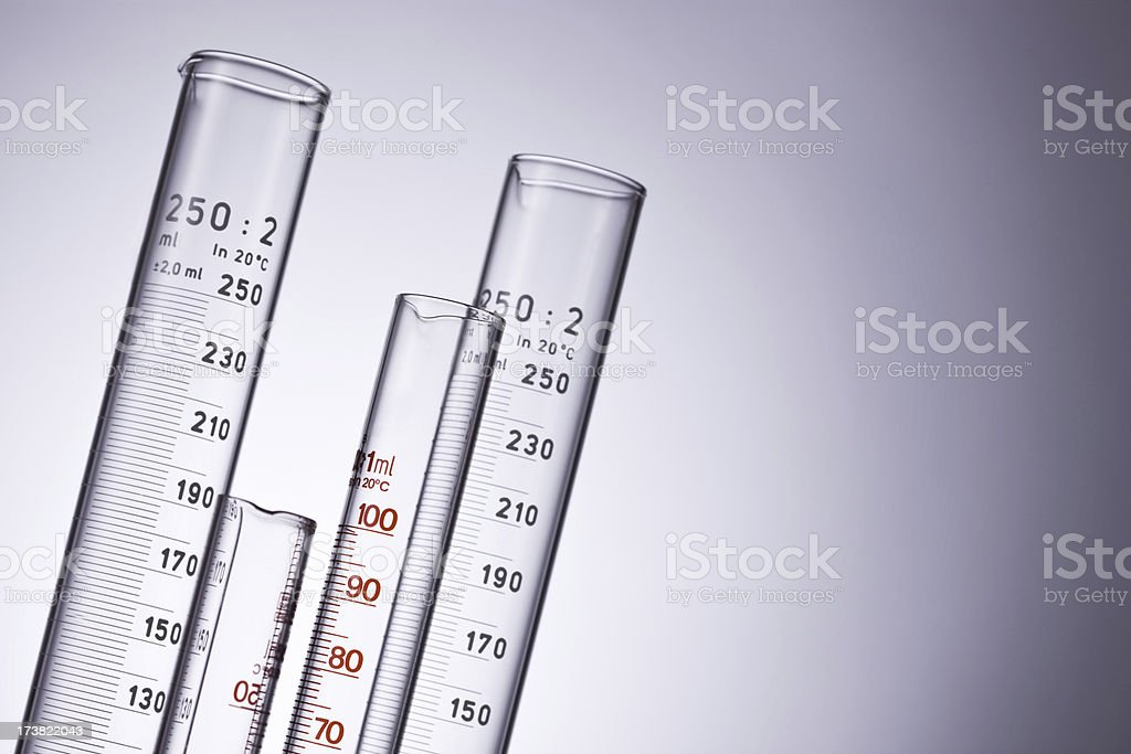 Measuring cylinders over isolaed background royalty-free stock photo