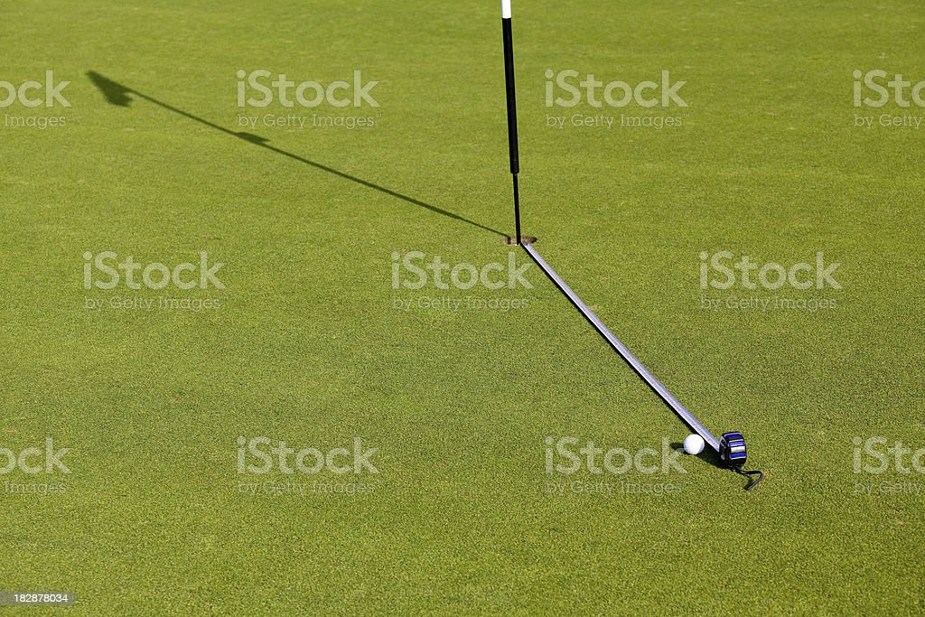 Measuring dinstance of golf ball to the target stock photo
