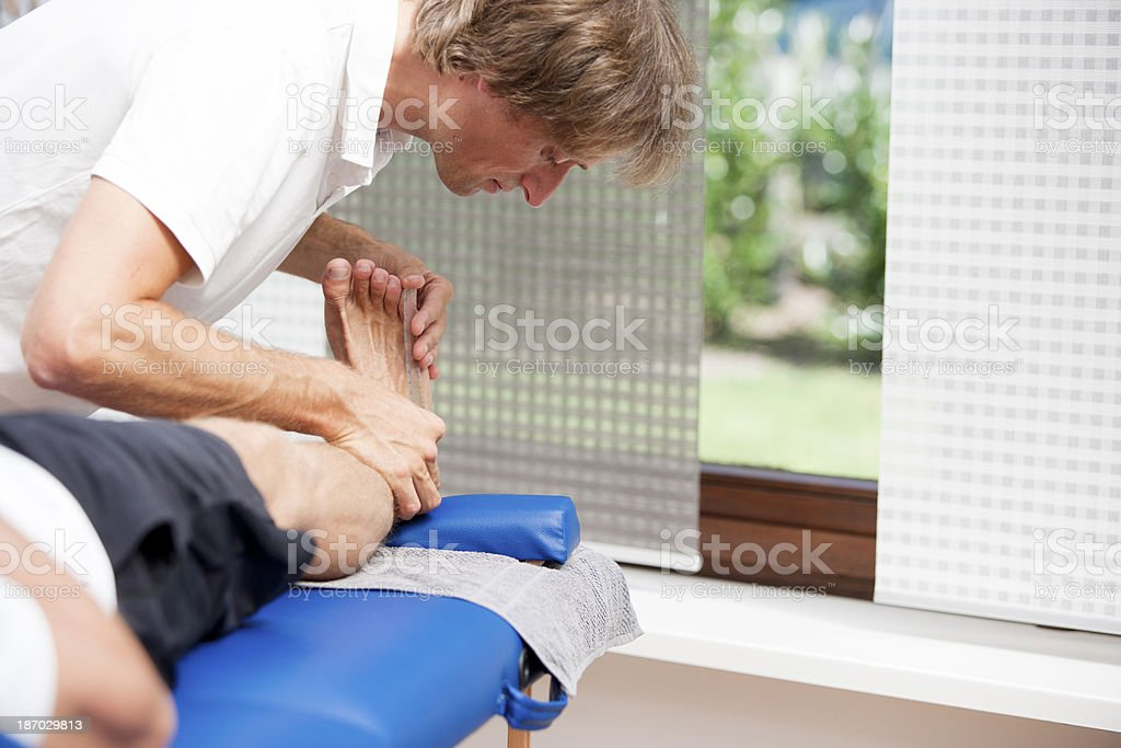 Measuring dorsalextension of foot. stock photo