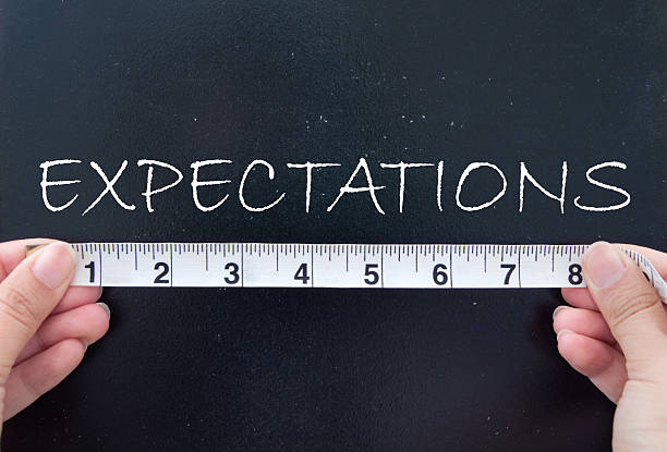 Measuring expectations stock photo