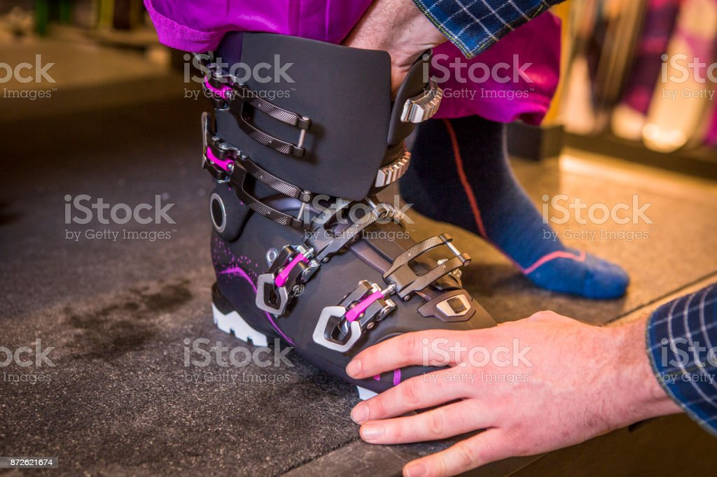 Measuring feet size in retail store. stock photo