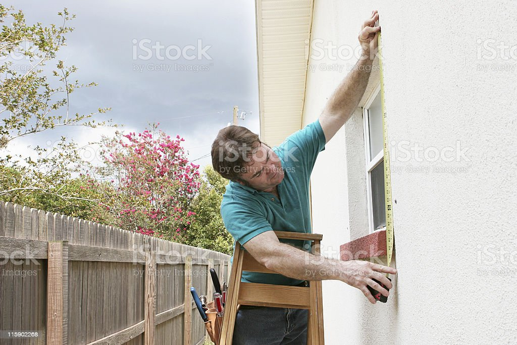 Measuring For Storm Shutters stock photo