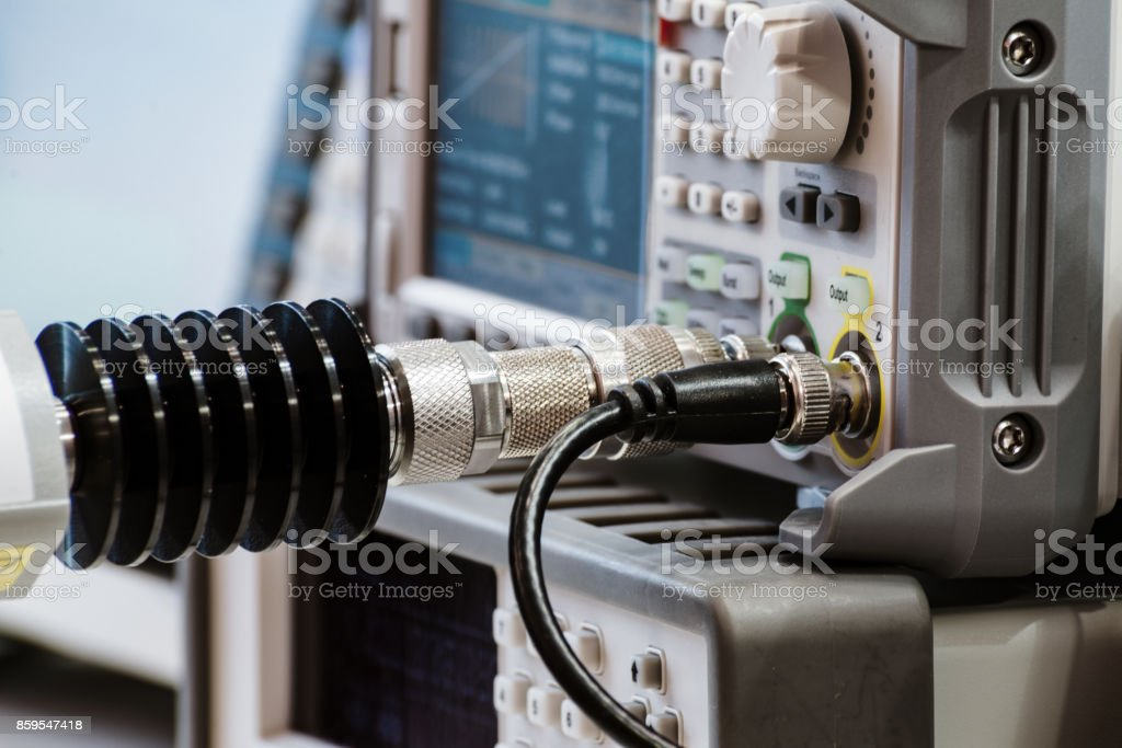 Measuring high-frequency equipment. Special high-frequency connectors are inserted into the instrument panel stock photo