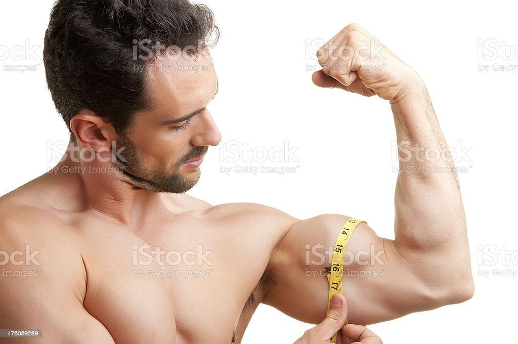 Medir sus bíceps - Foto de stock de Adulto libre de derechos