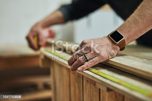Cropped shot of a carpenter working on a piece in his workshop