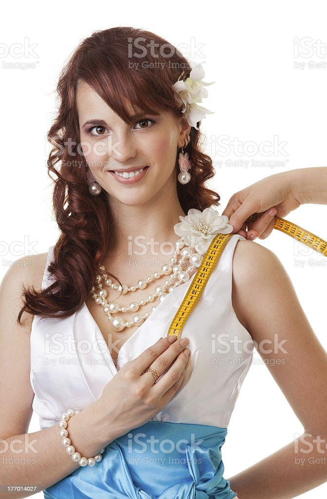 Measuring length from shoulder to breast close-up stock photo