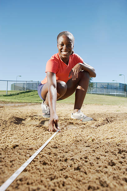 measuring long jump - judge sports official stock photos and pictures