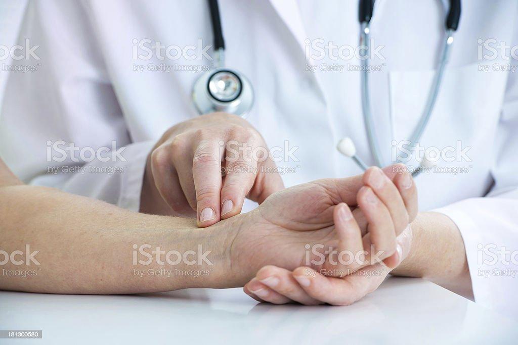 Measuring of pulse on wrist stock photo