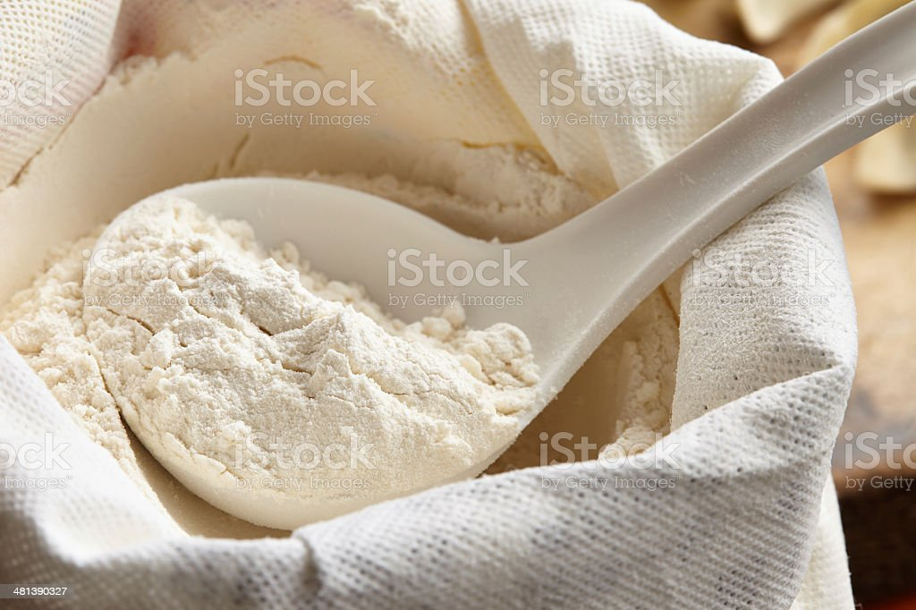 measuring scoop with flour stock photo