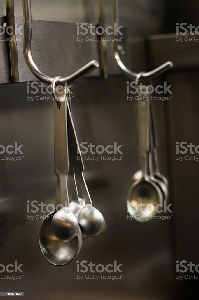 Measuring Spoons Hanging from metal hook stock photo