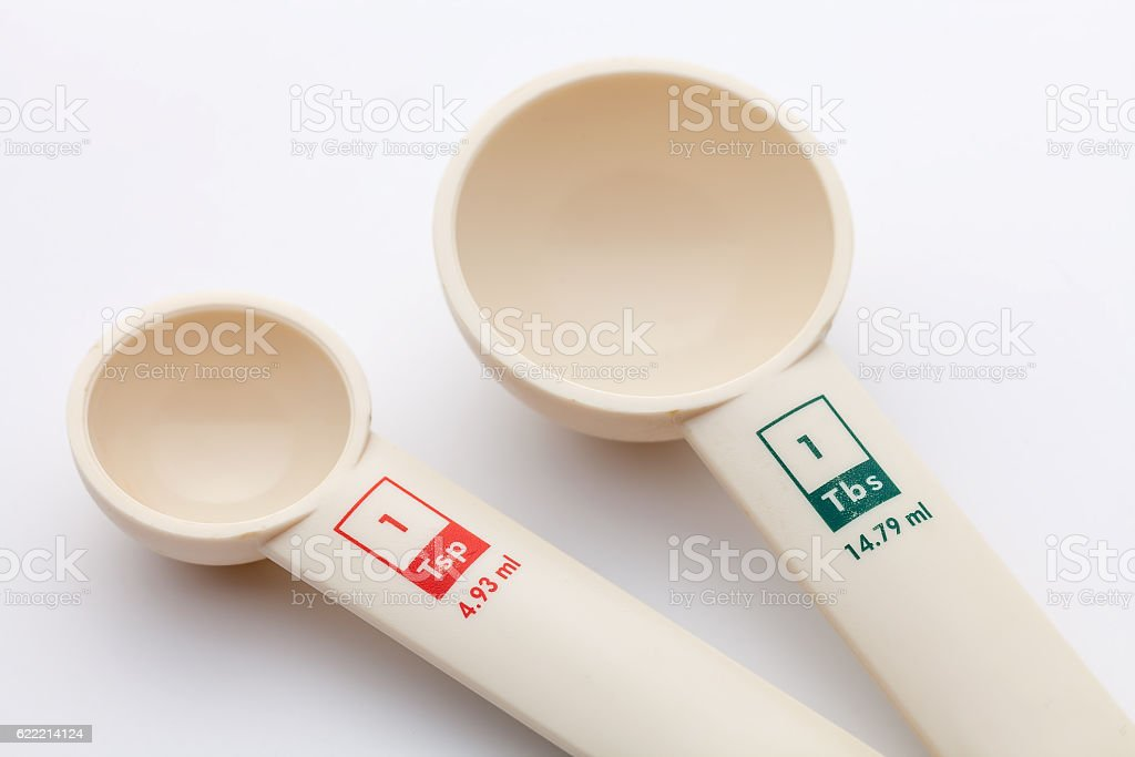 measuring spoons on white background stock photo