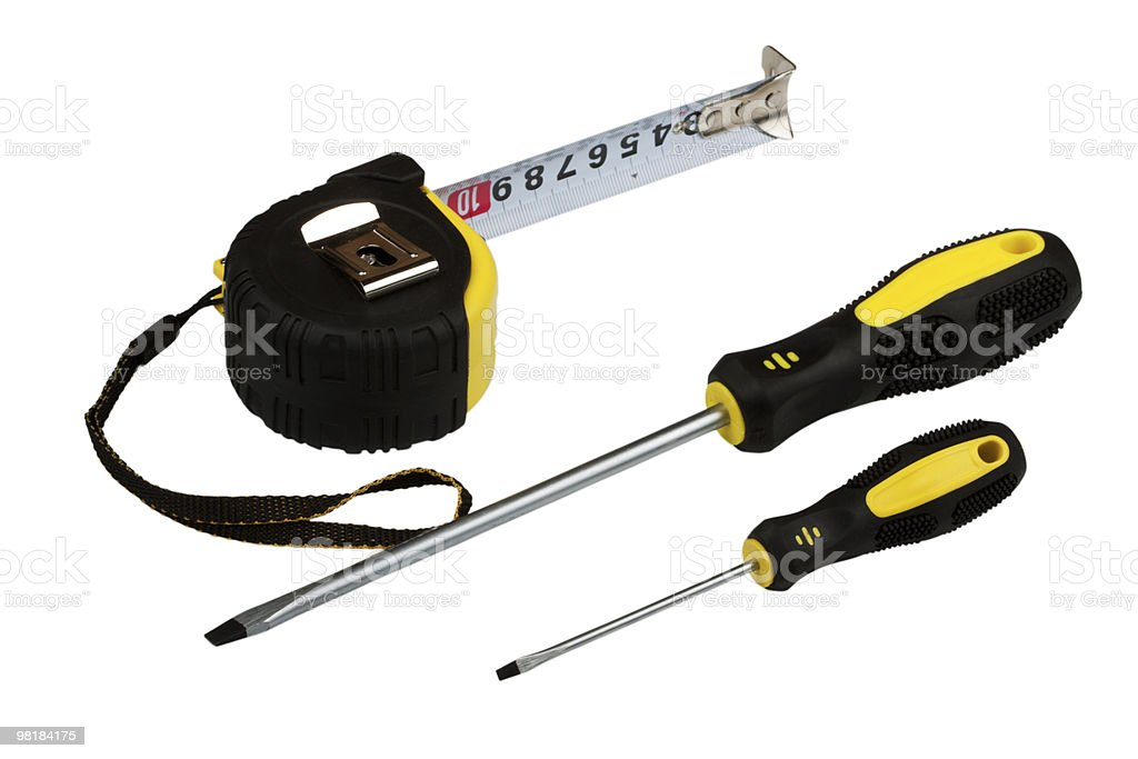 Measuring tape and two screw-drivers royalty-free stock photo