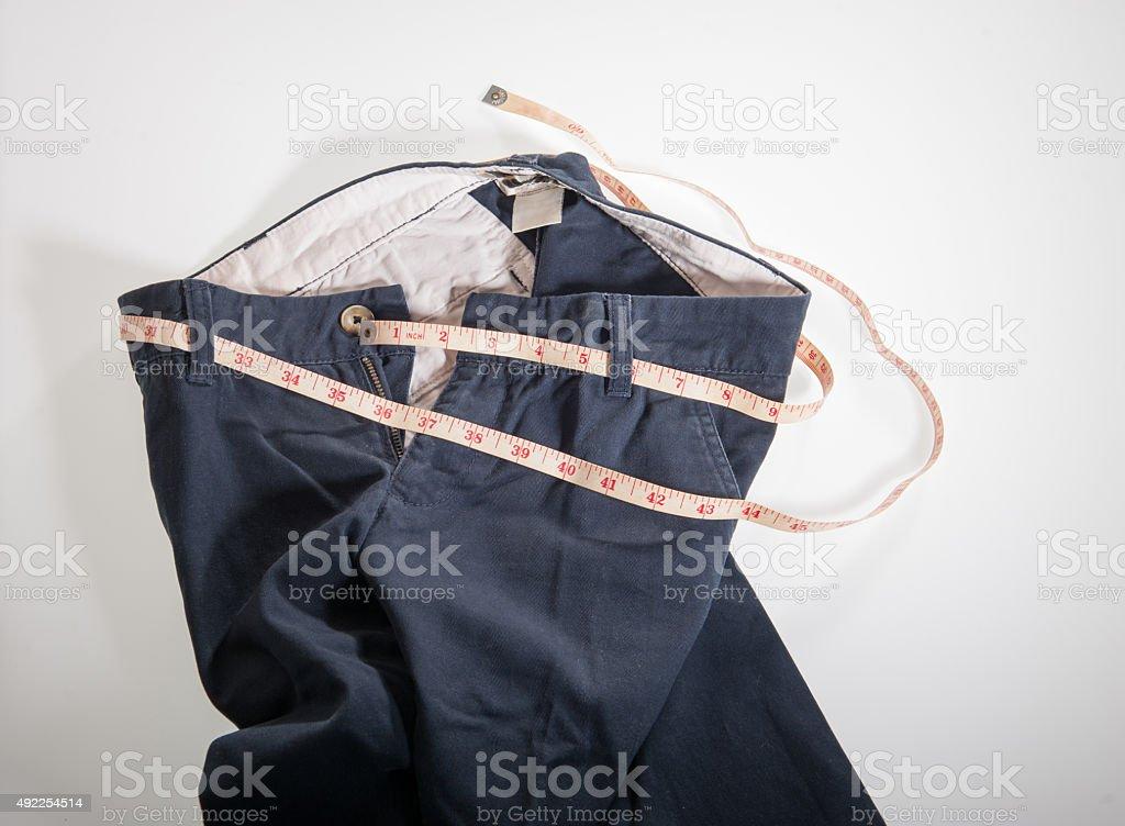 Cinta métrica alrededor de womans pantalones, foto de perfil estrecho - foto de stock