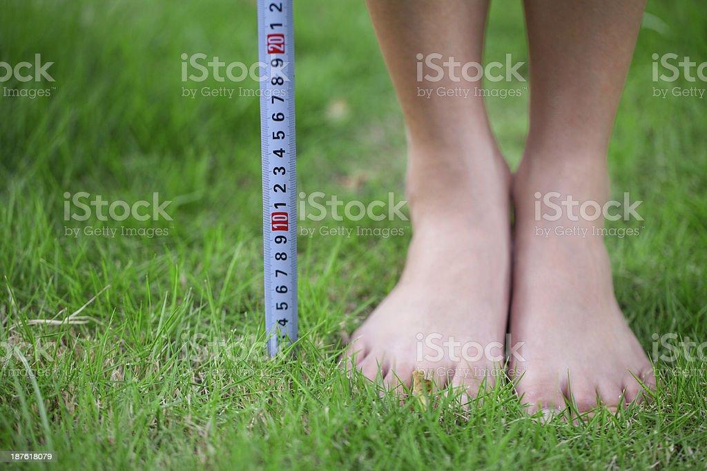 Measuring Tape Beside Human Foot royalty-free stock photo
