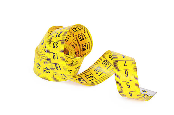 Measuring tape isolated on white background The measuring tape isolated on white backgroundThe measuring tape isolated on white background tape measure stock pictures, royalty-free photos & images