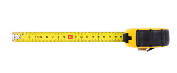 Measuring tape isolated on white background, top view Yellow measuring tape isolated on white background, top view tape measure stock pictures, royalty-free photos & images