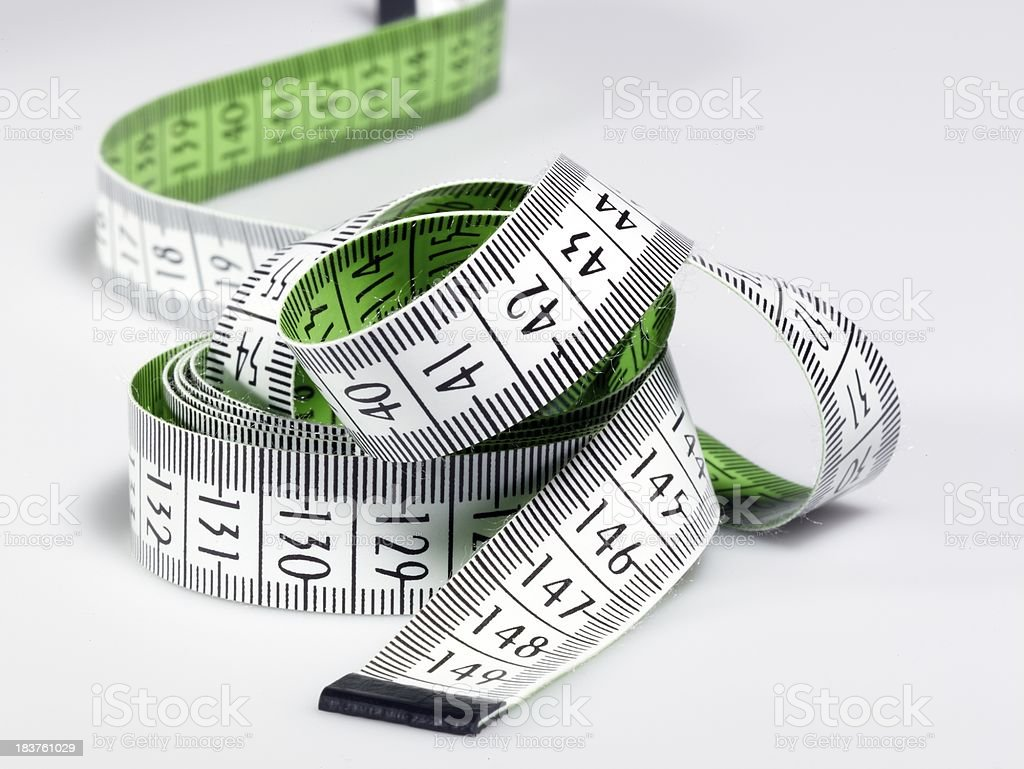 Measuring tape of the tailor , on white background royalty-free stock photo