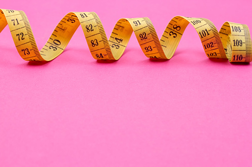 istock Measuring tape of the tailor 834725676