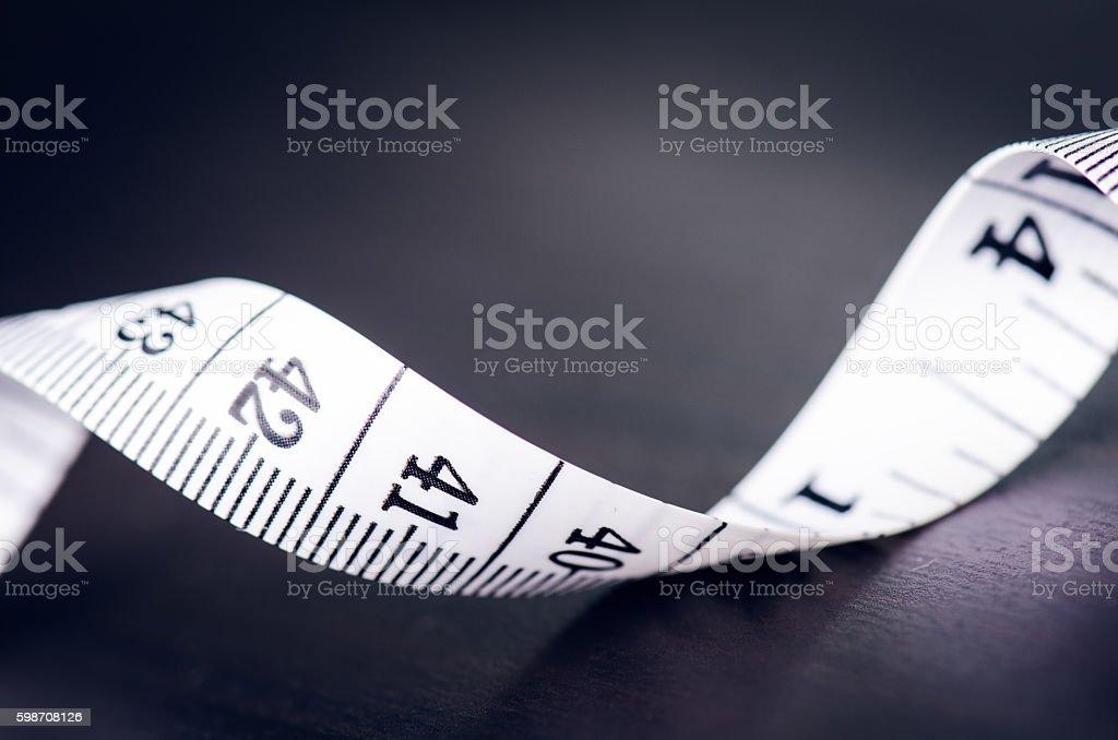 Measuring tape on dark background stock photo