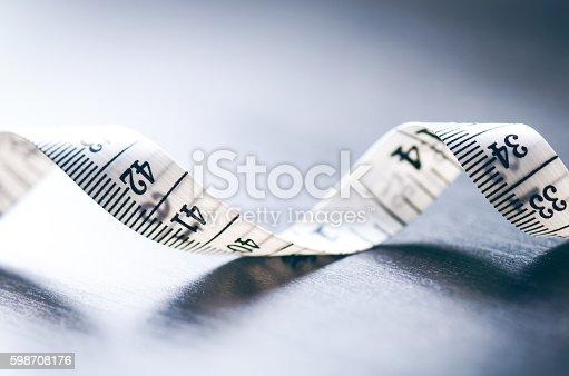 istock Measuring tape on dark background 598708176