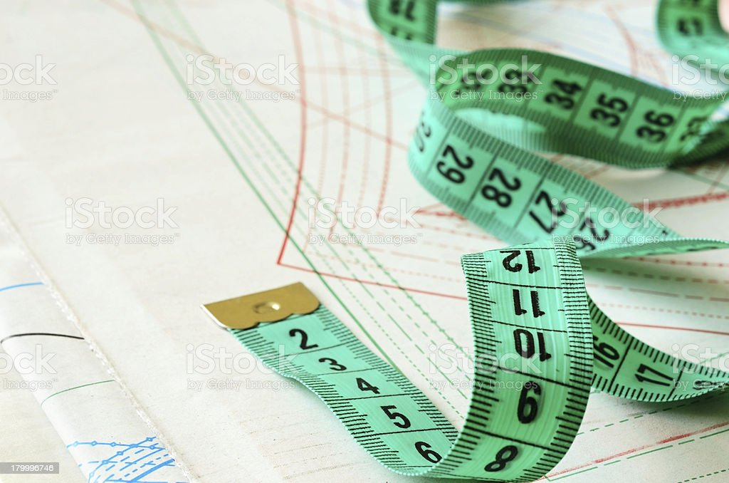 Measuring tape on patterns royalty-free stock photo