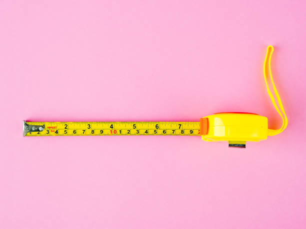 Measuring Tape on pink background Measuring Tape on pink background meter instrument of measurement stock pictures, royalty-free photos & images