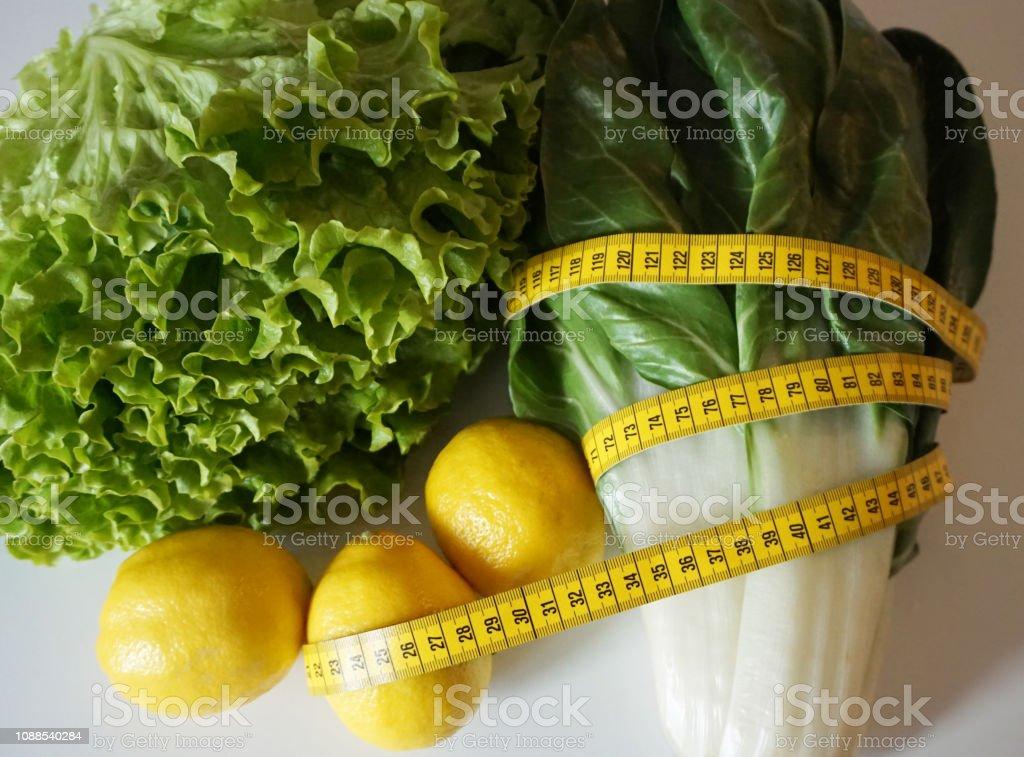 Fantastic Measuring Tape On Vegetables And Lemon Healthy Food For Download Free Architecture Designs Scobabritishbridgeorg