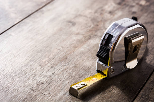 Measuring tape on wooden table Measuring tape on wooden table tape measure stock pictures, royalty-free photos & images