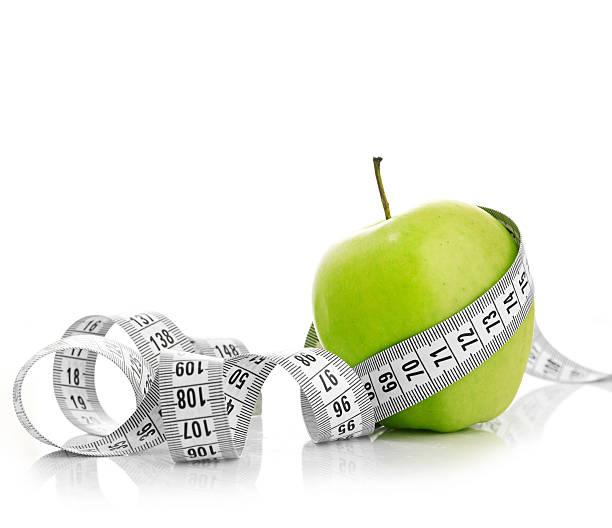 Cтоковое фото Измерительная лента вокруг apple с зеленой