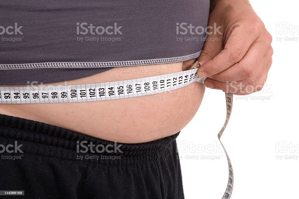 Measuring the beerbelly royalty-free stock photo