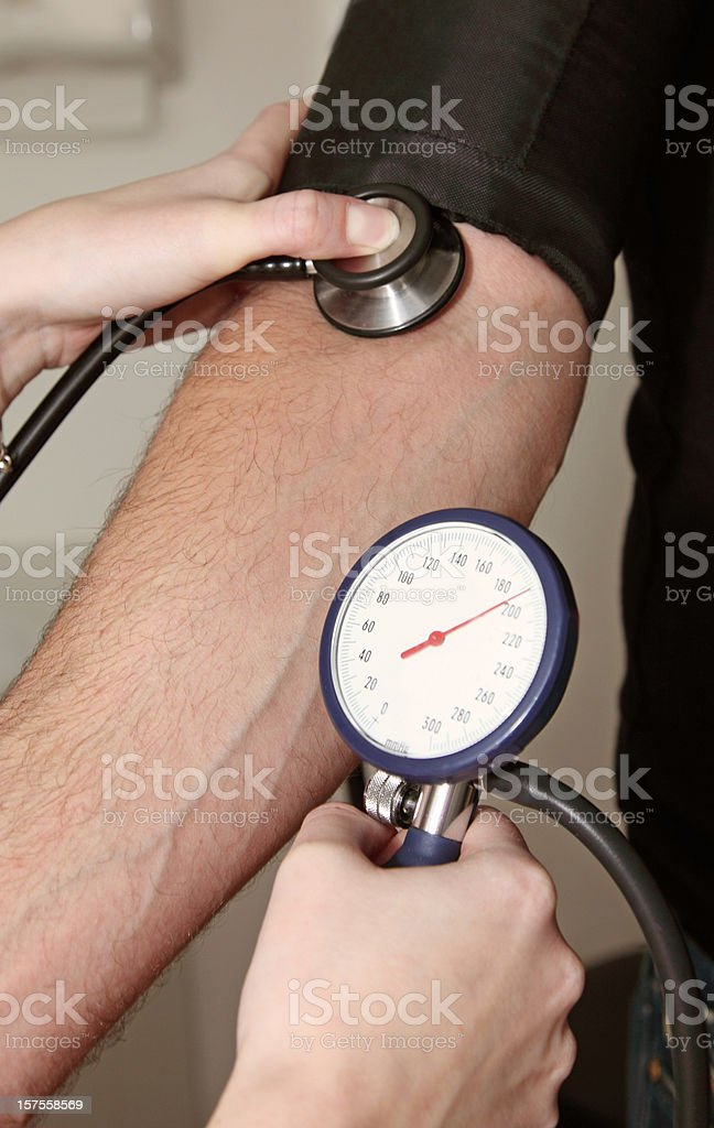 Measuring the blood pressure royalty-free stock photo