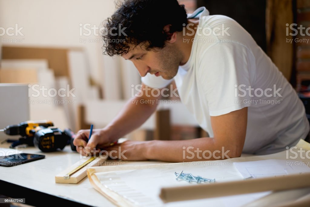 Measuring the cutting board royalty-free stock photo