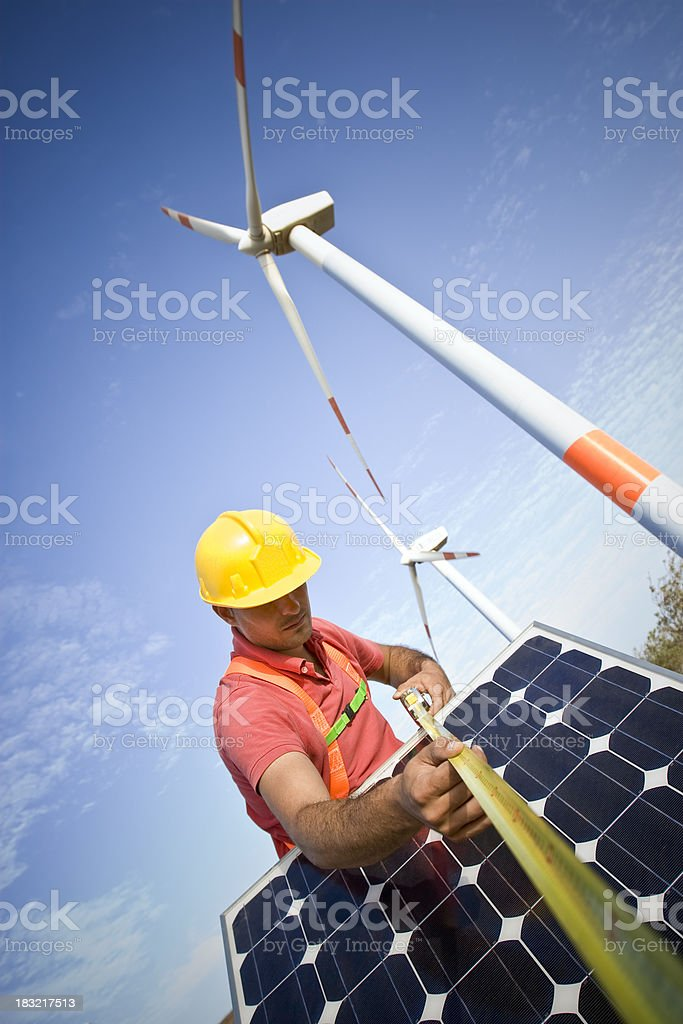 Measuring the length of a solar panel royalty-free stock photo