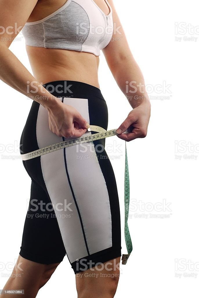 Measuring waist - woman body royalty-free stock photo